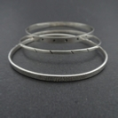 three thin silver bangles